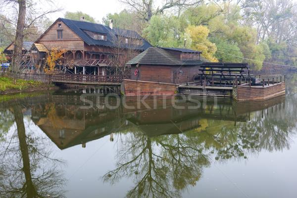 Víz malom csónak Szlovákia ősz építészet Stock fotó © phbcz