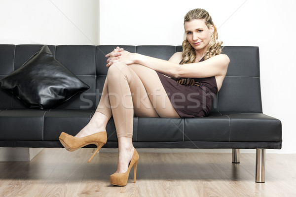 woman wearing brown pumps sitting on sofa Stock photo © phbcz