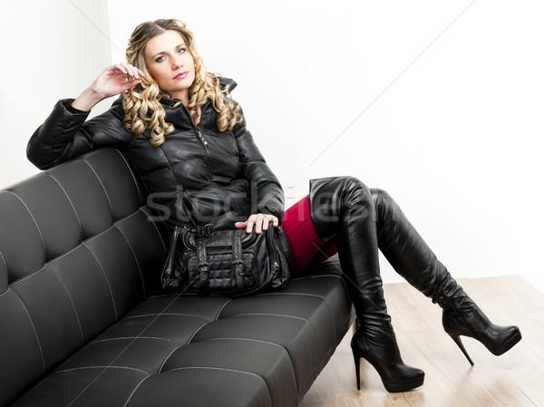 Nő visel divatos ruházat ül kézitáska Stock fotó © phbcz
