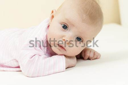 portrait of lying three months old baby girl Stock photo © phbcz