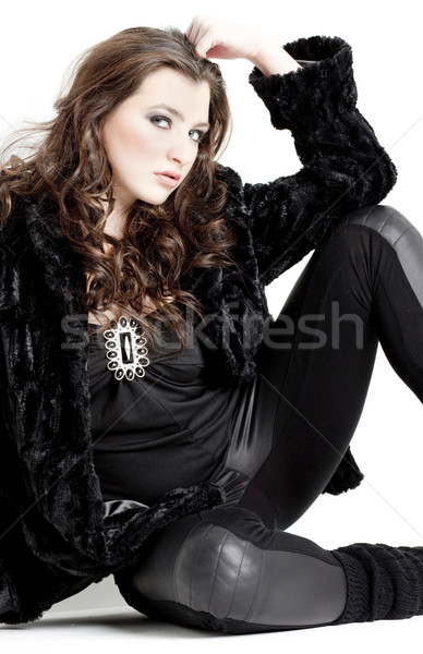 sitting young woman wearing black clothes Stock photo © phbcz