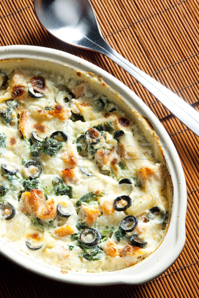 baked gnocchi with salmon, spinach and black olivves Stock photo © phbcz