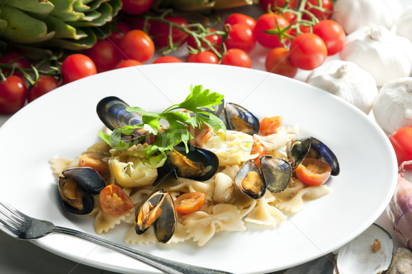 pasta with mussels, artichokes and cherry tomatoes Stock photo © phbcz