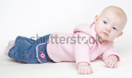 lying down baby girl Stock photo © phbcz