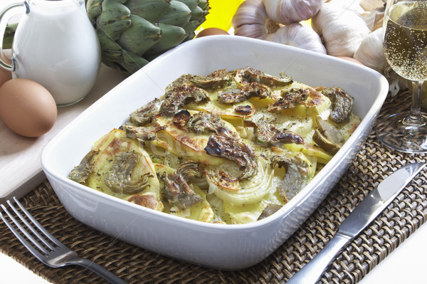 baked potatoes with artichokes Stock photo © phbcz