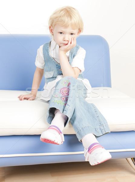 little girl sitting on sofa Stock photo © phbcz