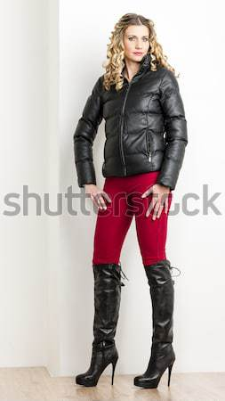 portrait of standing young woman wearing extravagant boots Stock photo © phbcz