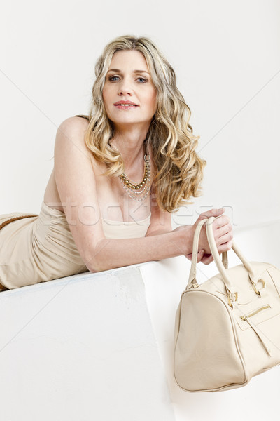 portrait of lying woman wearing summer clothes with a handbag Stock photo © phbcz