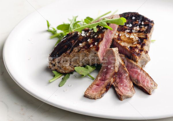 grilled beefsteak pickled in Dijon mustard with ruccola Stock photo © phbcz