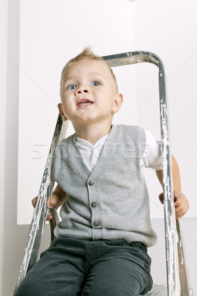 portrait of little boy sitting on stepladder Stock photo © phbcz