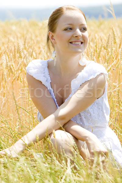 portrait of woman sitting in grain field Stock photo © phbcz