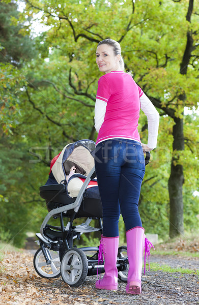 woman with a pram on walk in alley Stock photo © phbcz