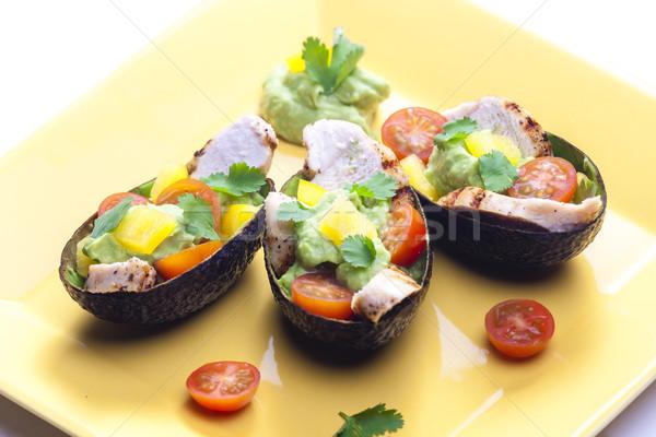 Abacate salada de frango molho prato tomates pimenta Foto stock © phbcz