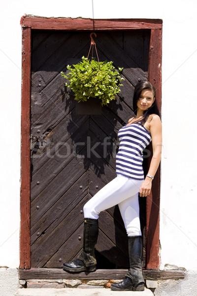 Lovas nő ajtó fiatal egyedül fiatalság Stock fotó © phbcz