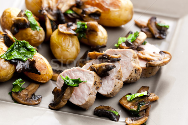 pork tenderloin baked on mushrooms Stock photo © phbcz