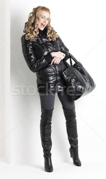 Permanent femme noir vêtements Photo stock © phbcz