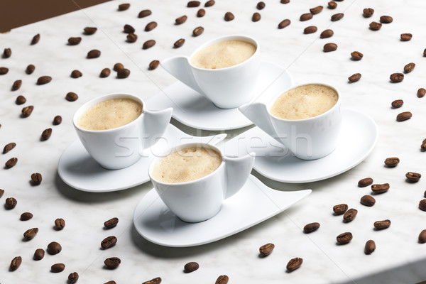 four cups of coffee with milk Stock photo © phbcz