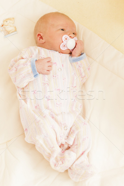 lying newborn baby girl Stock photo © phbcz