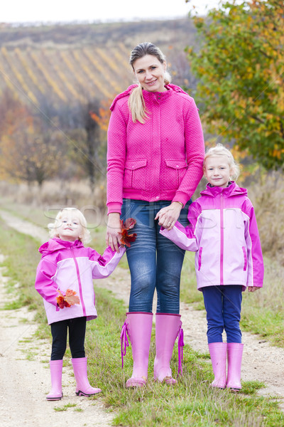 Mother and her daughters in autumnal nature Stock photo © phbcz