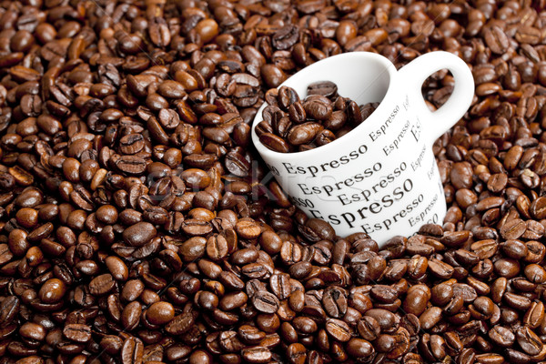 cup of coffee with coffee beans Stock photo © phbcz