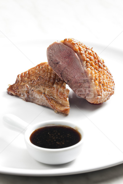 fried duck breast with sauce of honey, balsamico and red wine Stock photo © phbcz