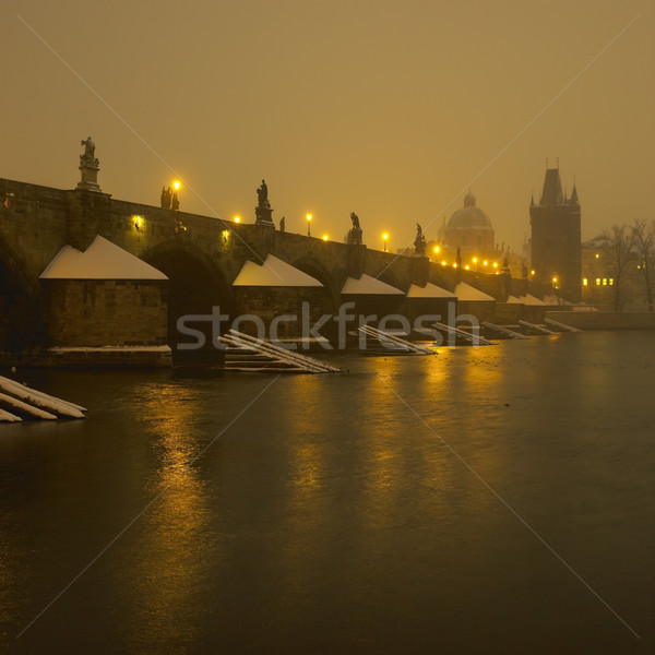 Charles bridge during night in winter, Prague, Czech Republic Stock photo © phbcz