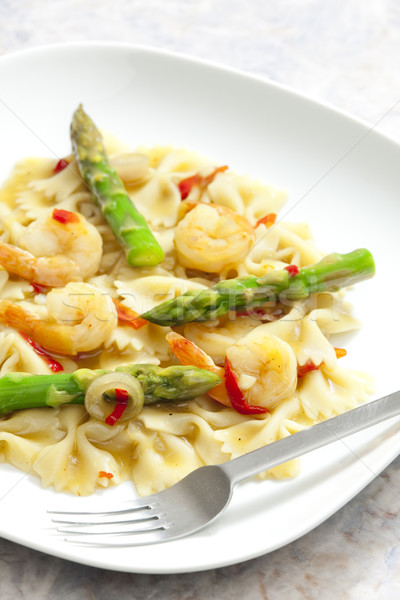 hot pasta farfalle with asparagus and prawns Stock photo © phbcz