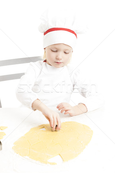 little girl cutting cookies Stock photo © phbcz