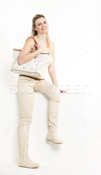sitting woman wearing summer clothes and boots Stock photo © phbcz