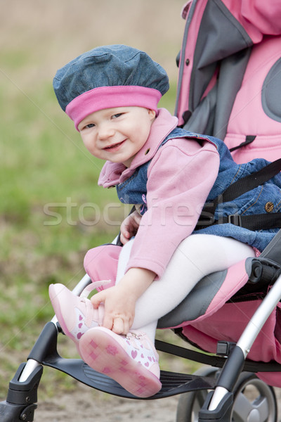 toddler sitting in a pram Stock photo © phbcz