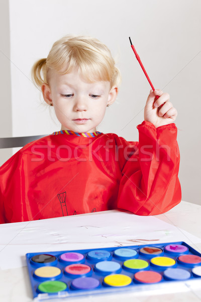 little girl painting with watercolors Stock photo © phbcz