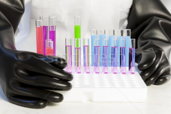 Részlet nő teszt csövek laboratórium kéz Stock fotó © phbcz