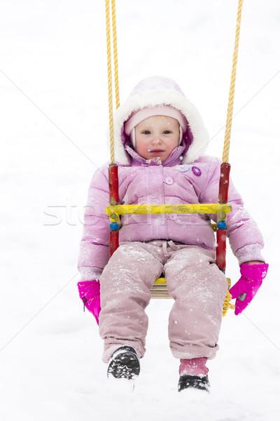 Küçük kız oturma salıncak kış kız çocuk Stok fotoğraf © phbcz