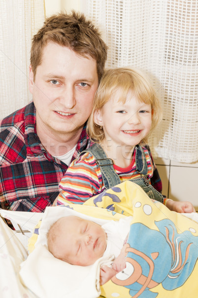 portrait of father with her daughters in maternal hospital Stock photo © phbcz