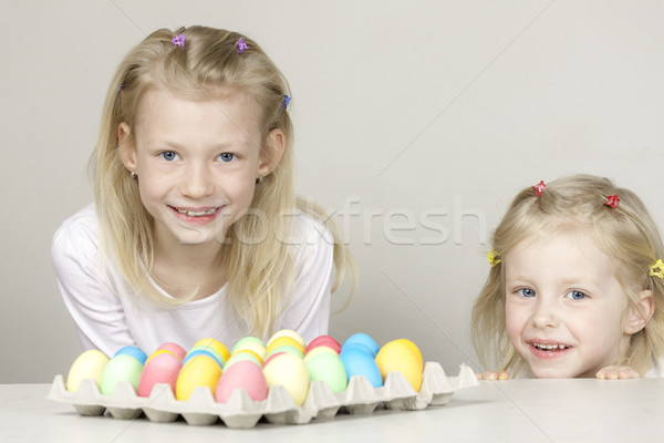 little girls with Easter eggs Stock photo © phbcz