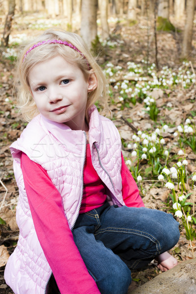little girl with snowflakes in spring nature Stock photo © phbcz