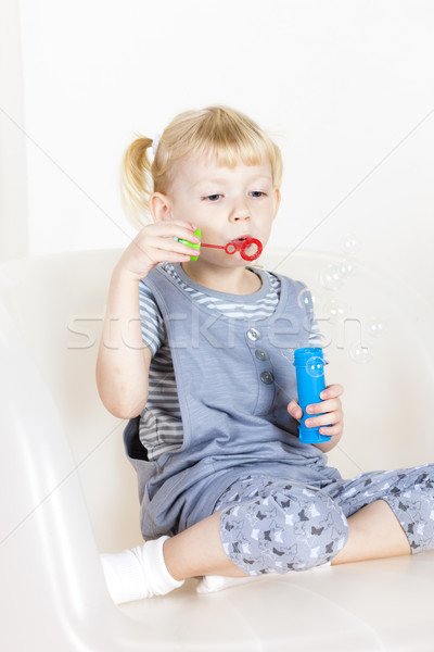 little girl playing with a bubbles maker Stock photo © phbcz