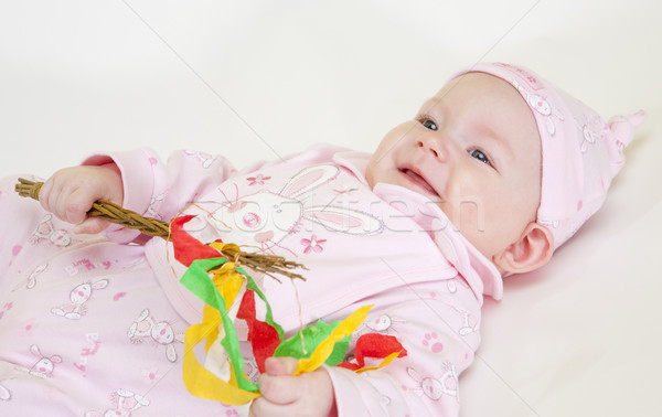 portrait of lying down baby girl holding a willow stick (Czech E Stock photo © phbcz