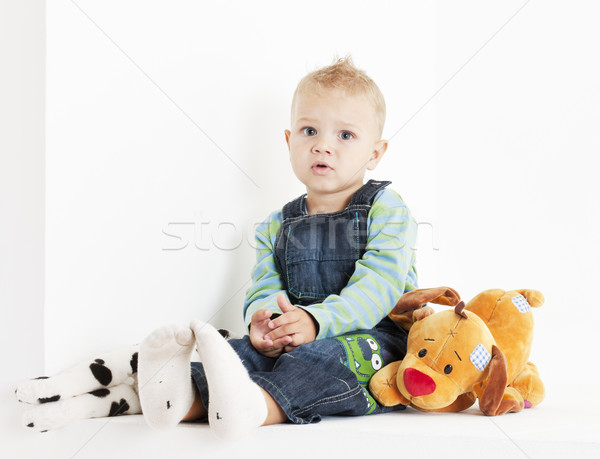 sitting toddler with toys Stock photo © phbcz