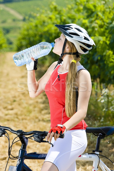 Motoros üveg víz szőlőskert nő sportok Stock fotó © phbcz