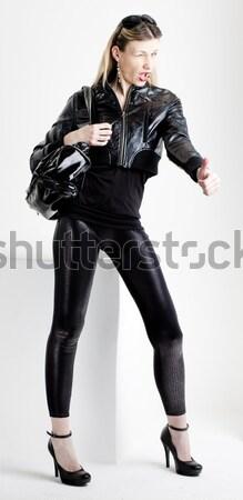 ül fiatal nő visel extravagáns ruházat nők Stock fotó © phbcz