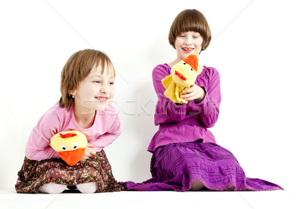 two sisters with glove puppets Stock photo © phbcz