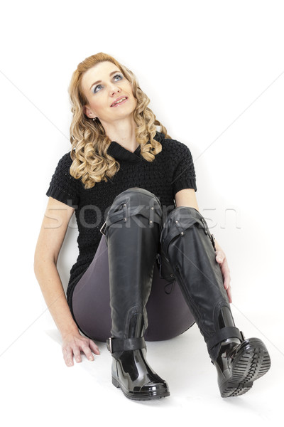 sitting woman wearing black clothes and black boots Stock photo © phbcz
