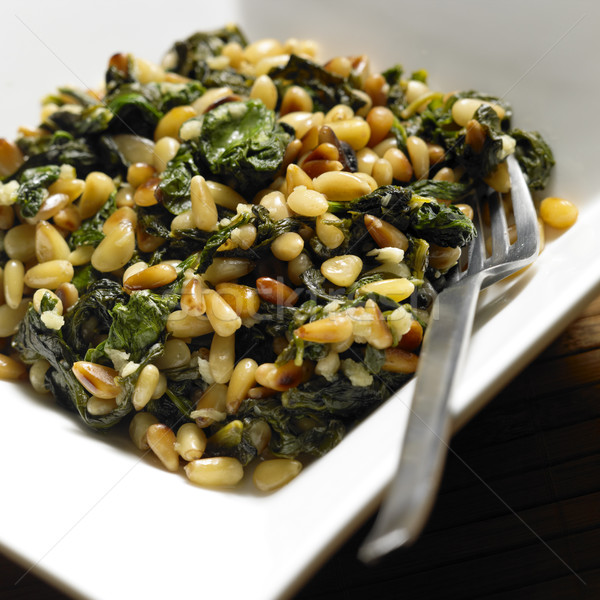 spinach with pine nuts Stock photo © phbcz