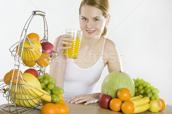 женщину завтрак яблоко фрукты здоровья оранжевый Сток-фото © phbcz