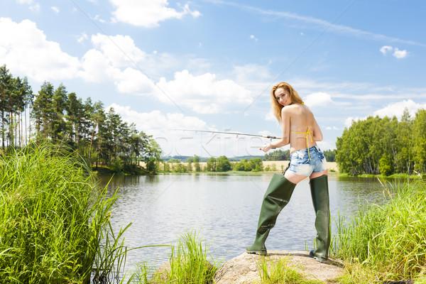 Fiatal nő halászat tavacska nyár nő bikini Stock fotó © phbcz
