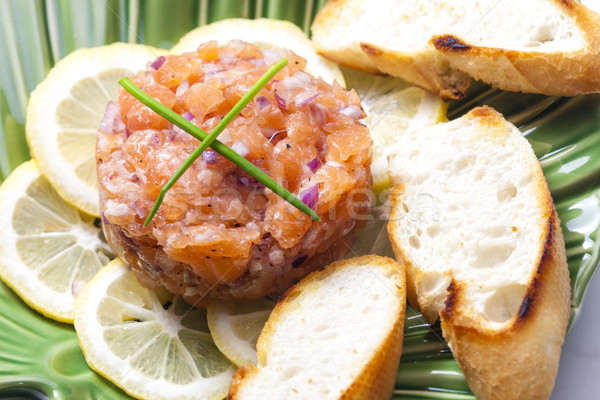 salmon tartar with red onion Stock photo © phbcz