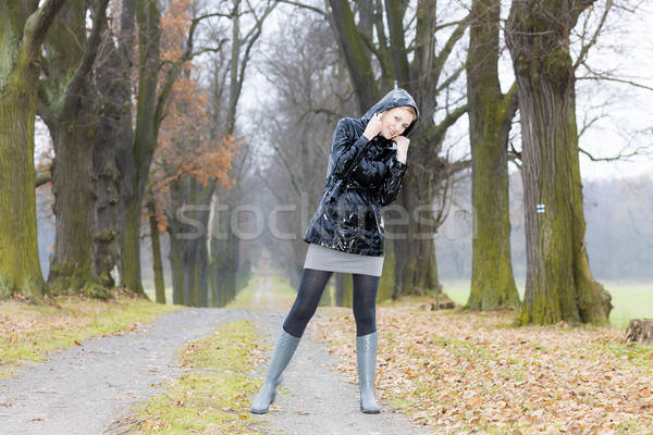 woman wearing rubber boots in autumnal alley Stock photo © phbcz
