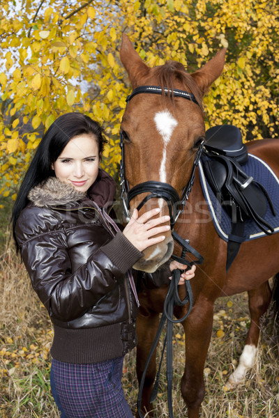 equestrian with her horse in autumnal nature Stock photo © phbcz