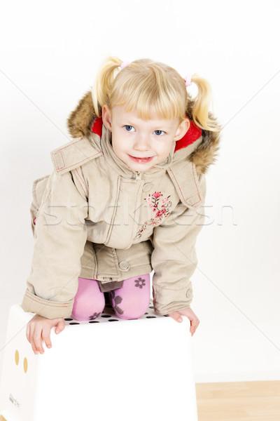 Kislány térdel zsámoly lány divat gyermek Stock fotó © phbcz